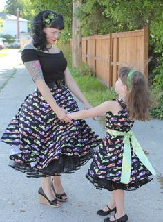 """$49.00 Hearse Print Swing Skirt by  Rockabetty 100% cotton back-zip skirt with a 2"""" waistband that hugs *just right*. The 25"""" length (from base of waistband) is the Perfect length for pairing with our Crinolines! Note: 2XL and 3XL are the same great style, but with a pull-on elasticized waistband rather than zip back. A full, but not too full skirt that fits all body types, in prints that are To-Die-For!!  Cheryl is pictured here with Rosie wearing the Bitsy Betty's Hearse Print Dress <3"""