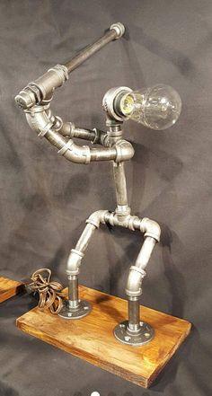 Adorable 35 Creative DIY Industrial Pipe Lamp Design Ideas Robot to Decor Your Home https://roomaniac.com/35-creative-diy-industrial-pipe-lamp-design-ideas-robot-decor-home/