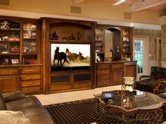 Check out these creative approaches to incorporating TVs and projection screens into the decor.