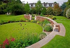 LOVE this dramatic sweeping curved wall #curves #design #gardendesign #grass #gardenwall #raised beds