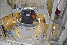 Our 1st completed @NASA_Orion crew module sits atop its service module @NASAKennedy. More: http://go.nasa.gov/1qHmxPc pic.twitter.com/7ZTVqLlyX4