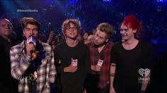 The boys introducing Paramore at the iheart radio festival 2014
