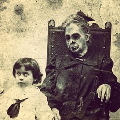 Well...this is a creepy post mortem! Some other pinners say the young boy is deceased too, but I don't think so. The boy is terrified! Imagine you are this little innocent boy and you should pose with a dead grandmother who looks to be just digged up again. Ieeeeeuw and yikes!