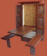 """We've seen in-wall beds, desks, shoe shine stands and ironing boards, but this is the first time we've seen an entire dining set do the Murphy. PocketTable.com is a carpentry shop in Ohio specializing in handmade cabinets, antique reproductions and restorations. But that's not why we're blogging it. Proprietor Pat McGeehan has gone online to sell two of his more universal problem-solving furniture designs: """"Knock-Down Wardrobes"""" and the aforementioned (and pictured) """"Pocket Table,"""" the…"""