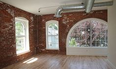 beautiful exposed brick and gorgeous arched windows in the LADDER 3 LOFTS in lynn massachusetts......converted in 2006 from the Franklin Firehouse which housed the Lynn Fire Department's Ladder 3 Company.......