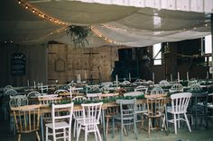 Chloe and Sam's modern spring woodland wedding with earthy organic decor, gold dipped feathers, and lush green and white florals Diy Outdoor Weddings, Painted Chairs, Wedding Chairs, Gold Dipped, Vintage Chairs, Woodland Wedding, Wedding Receptions, Boho Wedding Dress, Rustic Furniture