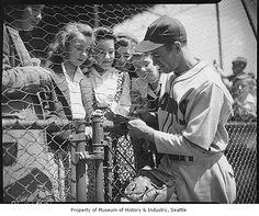 Seattle Rainiers shortstop Joe Dobbins signing autographs, Seattle, 1944 by IMLS DCC, via Flickr