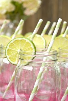 cute way to add your colors through fruit and straws to drinks.  Darling already on tables as part of decor