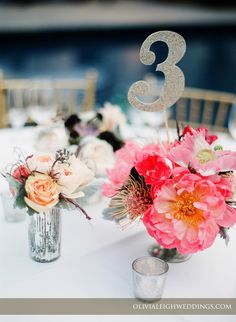 Coral charm, poppy & pincushion centerpieces at the Art Institute of Chicago. Photo by @Olivia Leigh