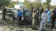 Cameroonian soldiers and officials surround the car from which a French family of seven were kidnapped February 2013; Waza National Park