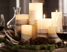 candle centerpieces with pinecone, pinebough, antler accents