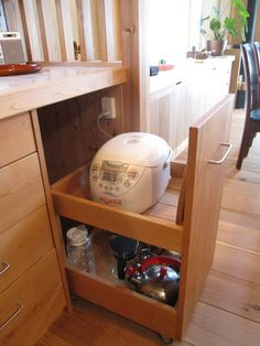 Rice cooker stored in the drawer. Note the outlet is inside of the cabinet. Smart!