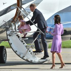 The youngster is helped onto the plane by her doting father as the family return home afte...
