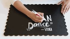 Using a chalkboard marker, trace and fill in the design.   Here's An Easy Way To Make Chalkboard Writing Look Fancy AF