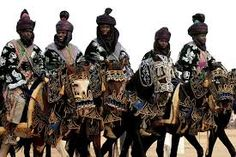 Men dressed in traditional clothes ride horses during the Durbar festival in Kano, Nigeria.