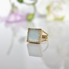 love this kind of setting: bright blue chalcedony ring gold ring square by AnemoneJewelry, $47.20