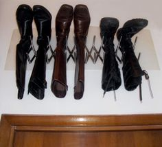 IKEA Hackers:  Wall-Mounted boots holder from a Pot Lid organizer