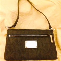 Michael Kors Mk logo Large Wristlet Michael Kors large Wristlet in black. Used once. Perfectly new condition. Front zipper pouch on front and 3 card slots with ID located on interior with zipper. Excellent new condition. Color is black. Michael Kors Bags Clutches & Wristlets
