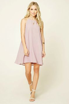 Forever 21 Contemporary - A woven slip dress featuring a round neckline, sleeveless cut, keyhole back, and a trapeze silhouette.
