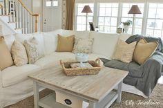 Love the sectional sofa and coffee table. I saved this for the lighting behind the couch