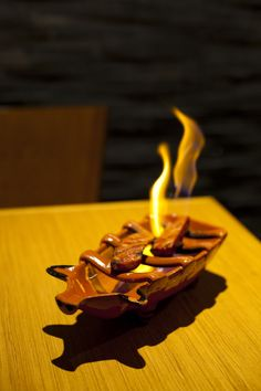 Flaming chorizo sausage at Alfama. Photo: Drew Anthony Smith for The New York Times