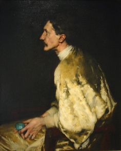 Portrait of Robert de Montesquiou (c. 1892) by Antonio de La Gandara (French 1861-1917)...in this rather unusual & striking composition the great aesthete, dandy and poet is swathed in golden velvet, and appears to be holding a large Ancient Egyptian lapis lazuli scarab beetle...looks like it anyway?