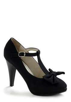 Modcloth No Need to Spree Heel in Black  A faux stacked stiletto heel and a bow at the toe make for a flirty update to your typical pump, while the vegan faux suede of these slightly platformed heels eliminates the need for any other footwear. When you slip these heels on with any LBD, sleek trousers, or evening dress for a night out, you'll be smiling, not only 'cause you look good, but 'cause you know this single shoe will solve your wardrobe woes.