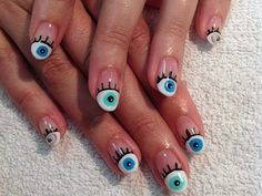 Would You Rock These Eyeball Nails?   I think they are interesting in a cool way =)