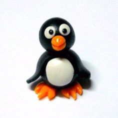 How to make a polymer clay penguin via @Guidecentral - Visit www.guidecentr.al for more #DIY #tutorials