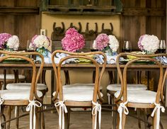 Alexis Swanson Traina - A rustic dining table topped with hydrangeas