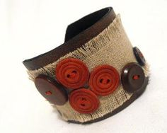 Button / burlap wrist cuff ... cute!  Links to Wanelo - a shopping site.  I pinned for a craft idea.
