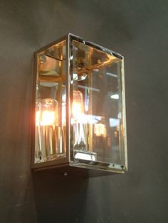 Single polished nickel wall light with glass front and sides