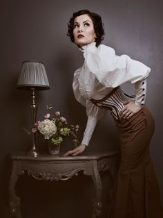 Gorgeous blouse! Over the top mutton chop sleeves, the buttons & classic black & white striped corsett. Ultra feminine, love!