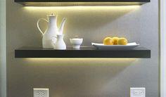 Use tape light under floating shelves. #lighting