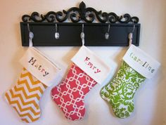 hang stockings from pub mirror  (make new stockings with names embroidered?) Super cute stockings!