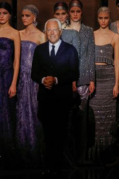 Mr. Armani still going strong on minimalism, allowing the fabrics speak of its own beauty. Gorgeous!