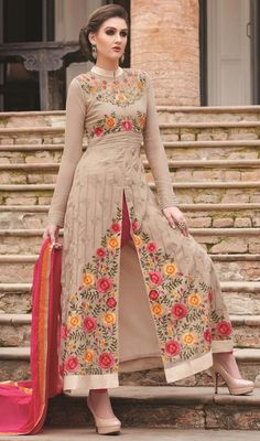 Redefine your personality with this beige color embroidered georgette pant style suit. Beautified with lace, patch and resham work. #standcollareddresses #longanklesuit #anklelengthsalwarkameez