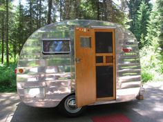 Featured Trailer – 1950 Kenskill Vintage Camper JULY 12, 2012 BY KELLE  This restored, 1950 Kenskill recently sold on eBay for $12,201. It measures a whopping 10 feet long and is truly a canned ham. It weighs in at 1400 lbs. Couldn't you just see yourself camping in this adorable little tin can.