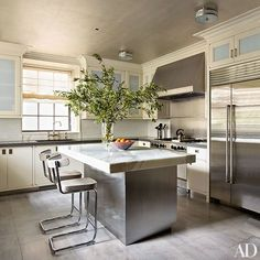 A New York kitchen with pale blue accents designed by Michael S. Smith | archdigest.com