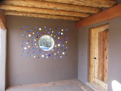 Sustainable Solar Home - Exterior Photos.  Beautiful wall using glass bottles.  Could do something similar in the garden?