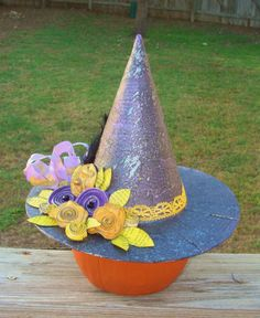 This altered paper mache' witch's hat shouldn't cost you more than $5 and a few supplies you probably have laying around the house. Use it as a Fascinator to give your pumpkin a stylish twist! Make your own using Smooch Spritz!