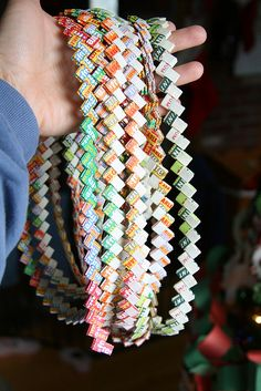 I remember sitting in our tent at Girl Scout camp and watching the other girls make gum wrapper chains.  I was so envious of 1) the fact that they HAD gum and 2) that they knew how to make these beautiful chains.  LOL