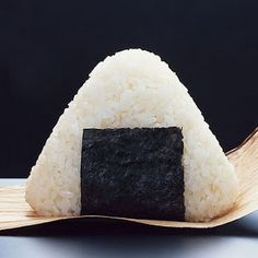 "Onigiri! Rice ""ball"" - sticky rice with a meat filling such as: bacon, chicken, tuna, or beef. I've always wanted to making these!"