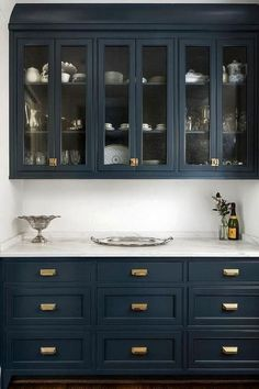 Navy cabinets look amazing with brass hardware and white carerra marble countertops, no doubt! But will they look dated years from now?Navy cabinets l Navy Kitchen Cabinets, Blue Cabinets, Painting Kitchen Cabinets, Pantry Cabinets, Upper Cabinets, Kitchen Paint, Colorful Kitchen Cabinets, Soapstone Kitchen, Pantry Doors