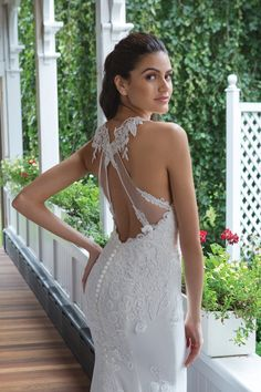 Charm the crowd in this Venice lace and chiffon gown. An illusion scoop neckline is graced with Venice lace appliques on the front and back bodice. Twirl around effortlessly in the fit and flare chiffon skirt with a chapel length train.