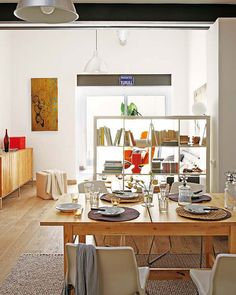 use bookshelf to separate - one side tv room other dining room, good use of space