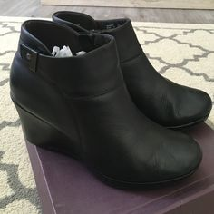 Clarks black leather wedge ankle boots Black leather ankle boots, really nice. Gently used but in great condition. Comes in box Clarks Shoes Wedges