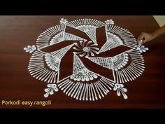 Creative rangoli design with dots Indian Rangoli Designs, Simple Rangoli Designs Images, Rangoli Designs Flower, Rangoli Border Designs, Rangoli Ideas, Rangoli Designs With Dots, Beautiful Rangoli Designs, Free Hand Rangoli Design, Small Rangoli Design