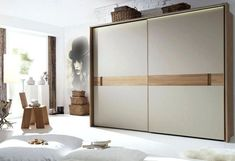 Popular choices for wardrobe with sliding doors stylish wardrobe design with modern sliding doors for minimalist bedroom ideas with unique wallpaper Fitted Wardrobe Design, Sliding Door Wardrobe Designs, Sliding Door Design, Wardrobe Design Bedroom, Modern Wardrobe, Bed With Wardrobe, Modern Closet Doors, Modern Sliding Doors, Minimalist Bedroom