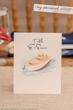 Nautical table card with watercolor row boat. www.mypersonalartist.com